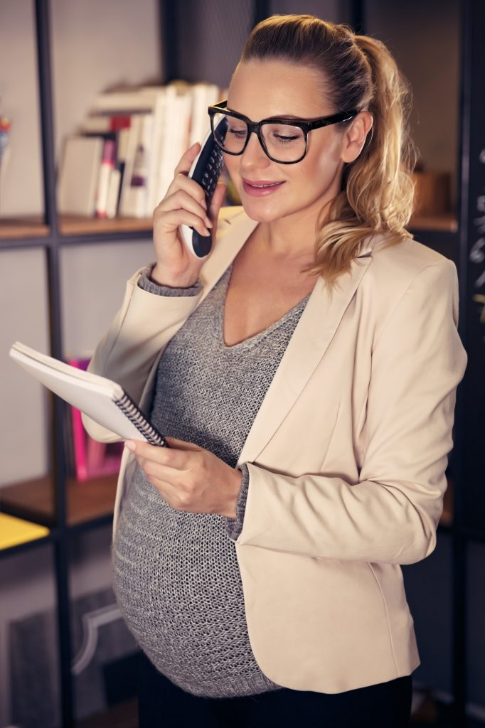 Pregnant female at work